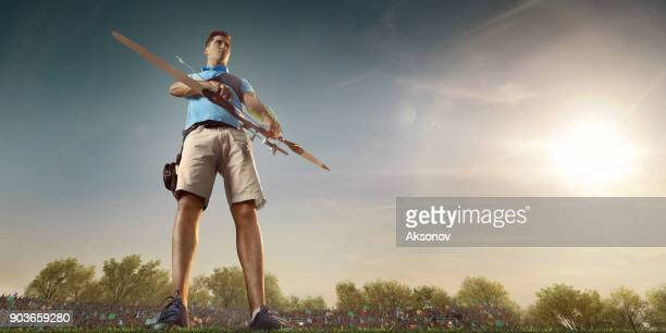 Male archer shooting with the longbow at sunset