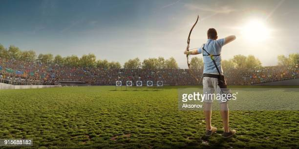 male archer shooting with the longbow at sunset - archery stock pictures, royalty-free photos & images