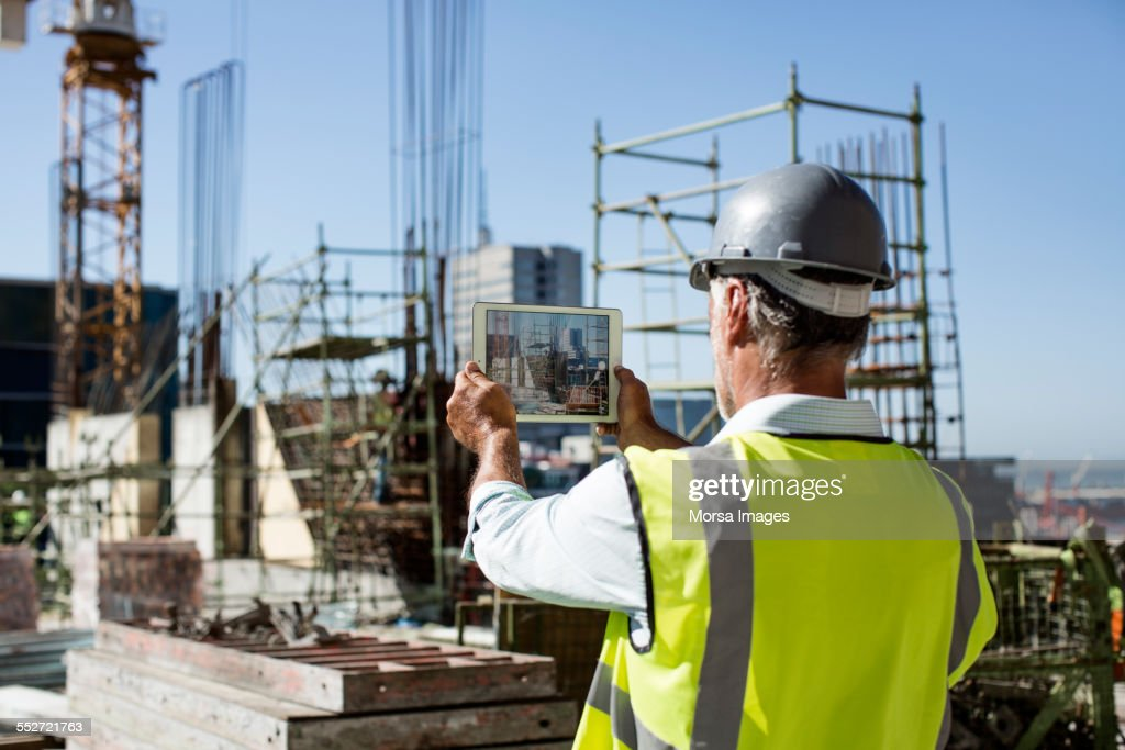 Male architect photographing construction site : Stock Photo