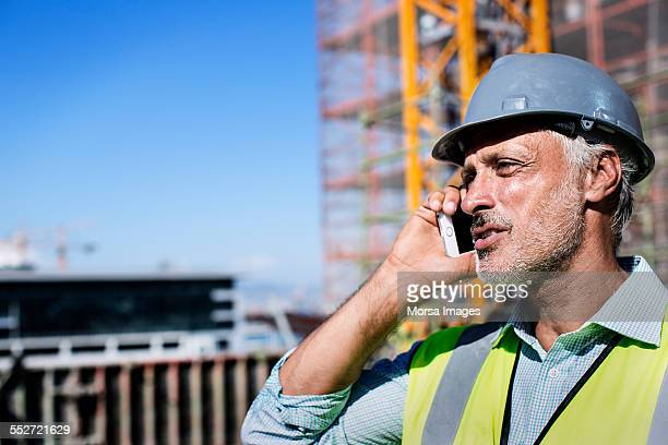 Male architect using mobile phone at site
