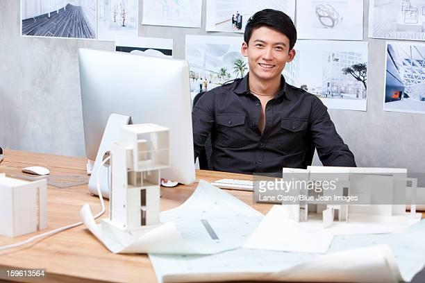 Male architect working in studio