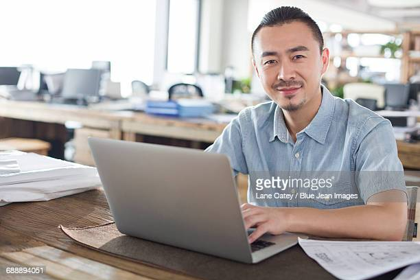 Male architect working with laptop in the office