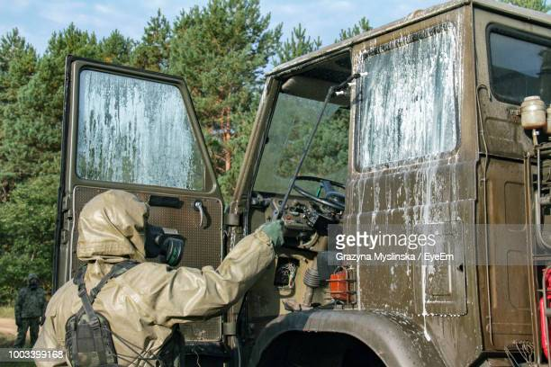 Male Army Soldier Disinfecting Truck