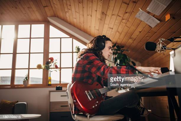 male artist making music in home recording studio - singer songwriter stock pictures, royalty-free photos & images