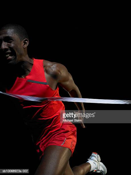 Male athlete crossing finishing line
