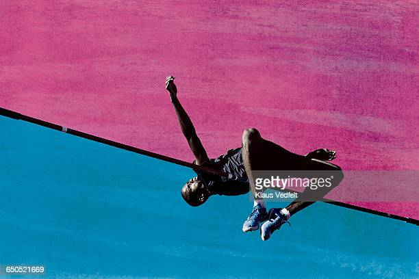 male athlete doing highjump - high jump stock pictures, royalty-free photos & images