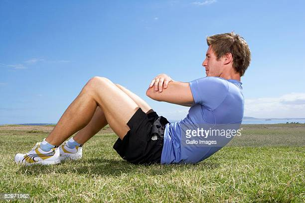 Male athlete doing sit-ups