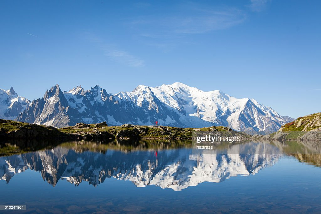 Male athlete enjoys a run in the French Alps : Foto de stock