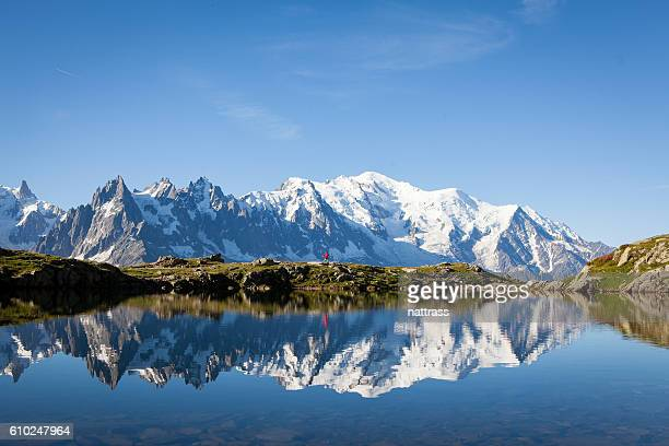 male athlete enjoys a run in the french alps - monte bianco foto e immagini stock