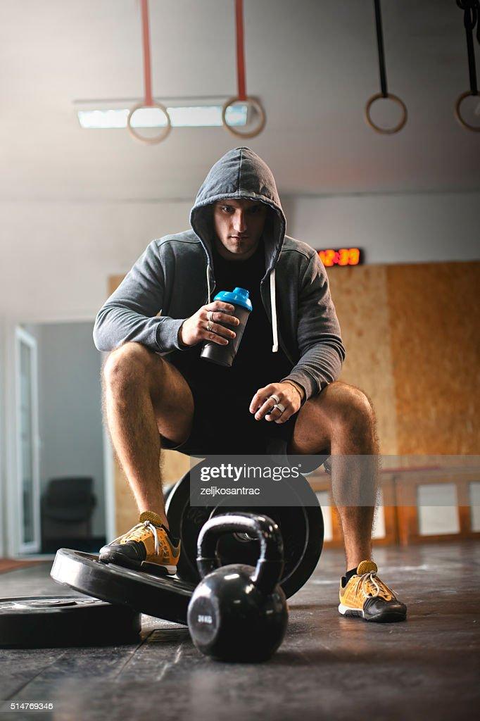 Male athlete enjoys delicious health drink : Stock Photo