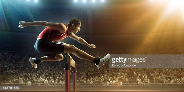 male athlete hurdling on sports race - hurdling stock photos and pictures