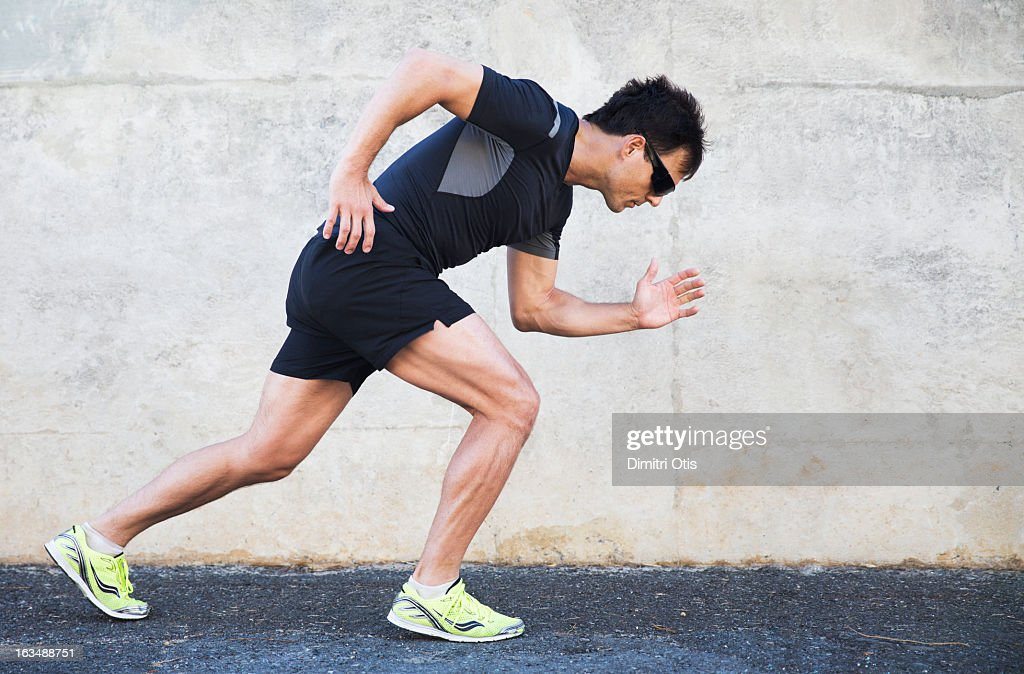 Male athlete in starting position to run : Stock Photo