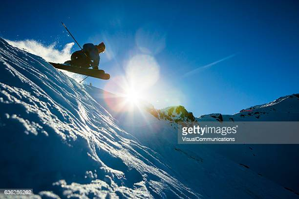 Male athlete jumping on skis.