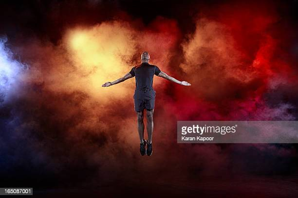 Male Athlete Leaping with arms streched