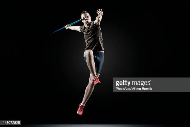 male athlete leaping with javelin - javelin stock pictures, royalty-free photos & images