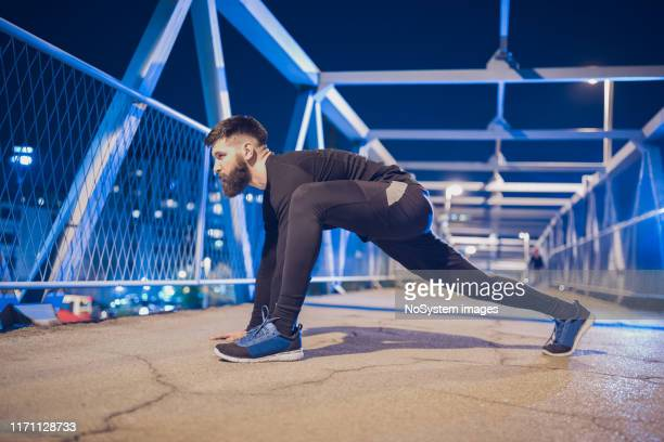 male athlete, night work out - one man only stock pictures, royalty-free photos & images