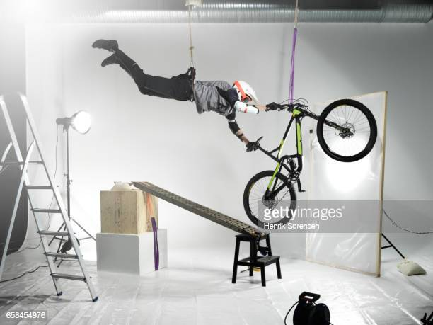 Male Athlete on mountain bike in a studio