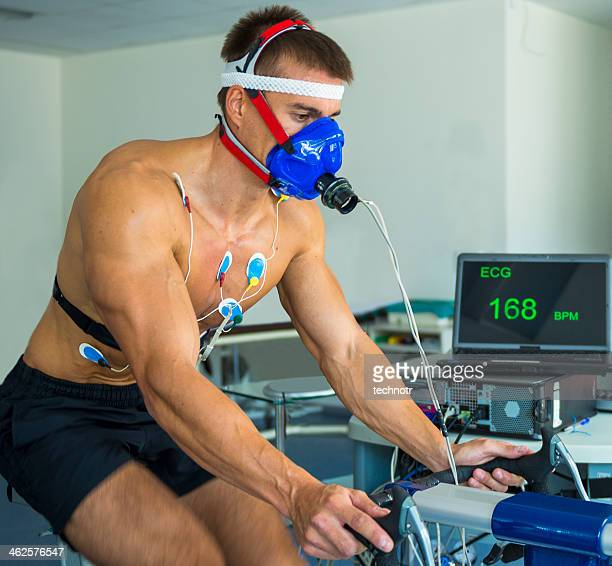 Male Athlete Performing ECG and VO2 test on Indoor Bicycle