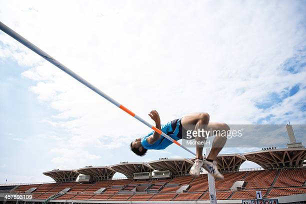 male athlete performing high jump