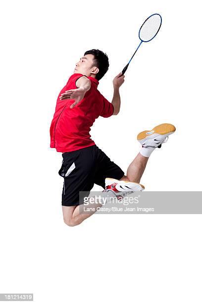 male athlete playing badminton - スポーツ バドミントン ストックフォトと画像