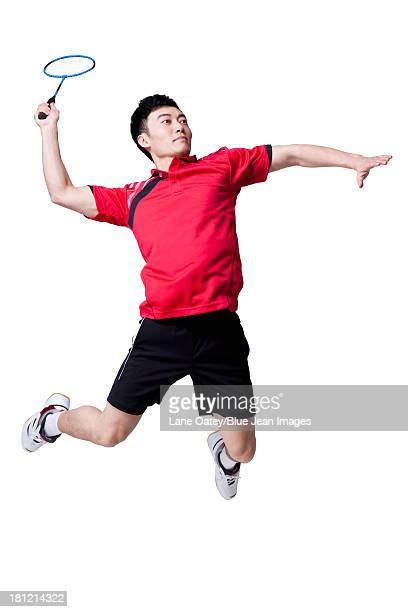 male athlete playing badminton - badminton sport stock photos and pictures