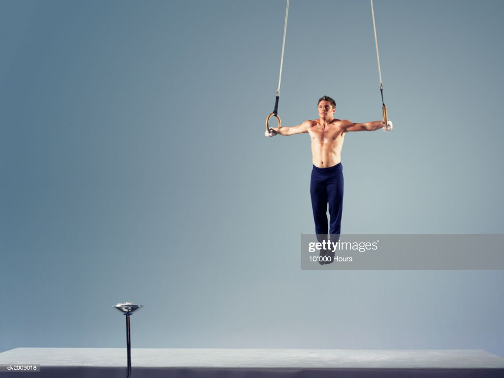 Male Athlete Practising a Rings Exercise : Stock Photo