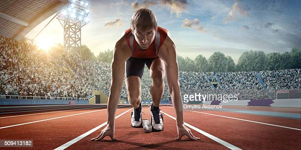 Male athlete prepares to run