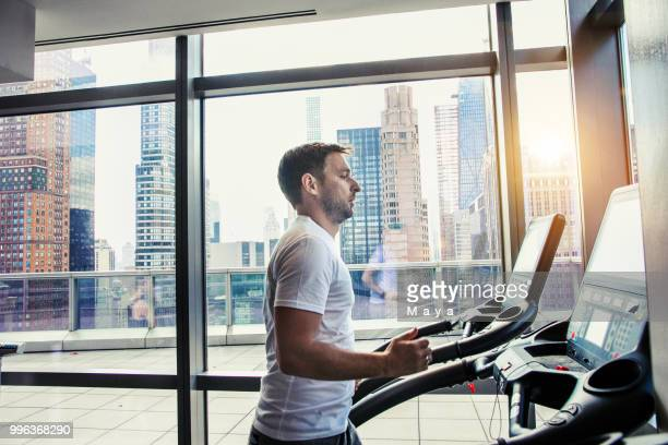 male athlete running on treadmill - center athlete stock pictures, royalty-free photos & images