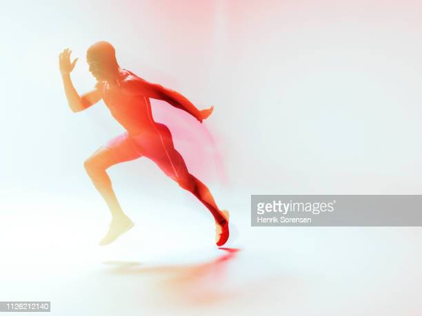 male athlete running - forward athlete stock pictures, royalty-free photos & images
