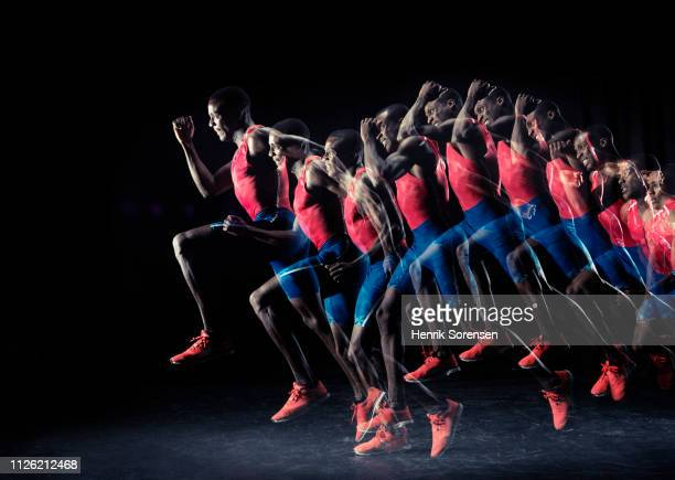 male athlete running - long exposure stock pictures, royalty-free photos & images