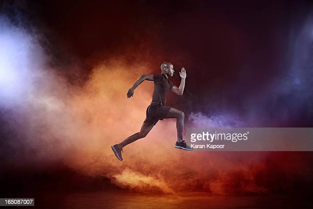 male athlete running - dry ice stock pictures, royalty-free photos & images