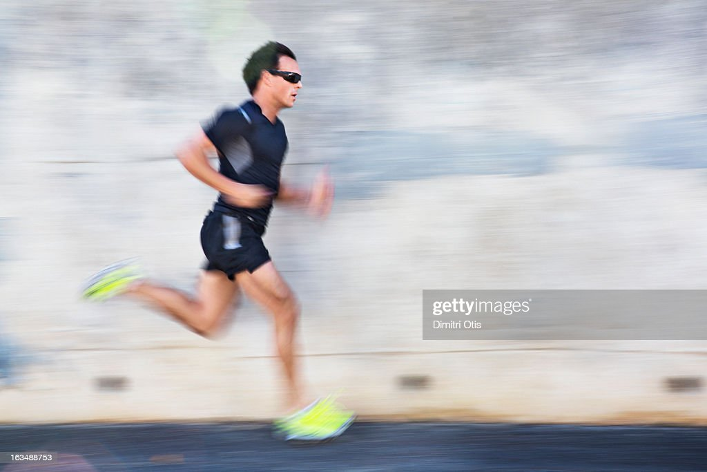 Male athlete running with motion blur : Stock Photo