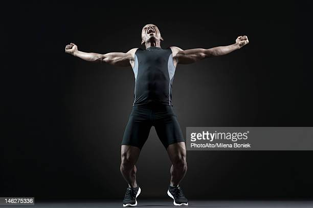 Male athlete shouting with excitement
