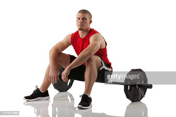 male athlete sitting on the barbell - running shorts stock pictures, royalty-free photos & images