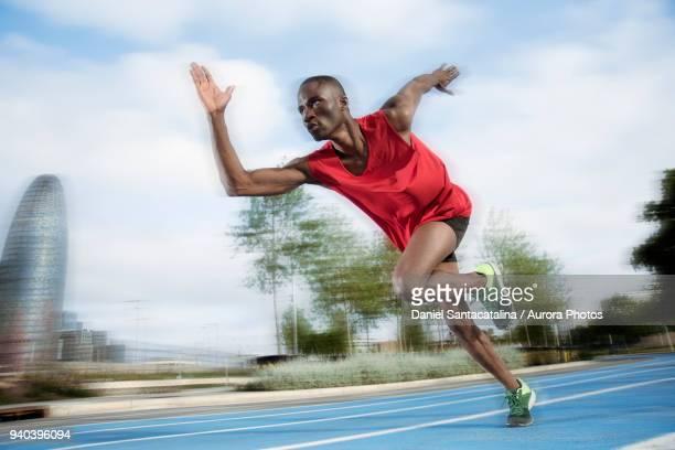 male athlete sprinting on all-weather running track, barcelona, spain - スプリント競技 ストックフォトと画像