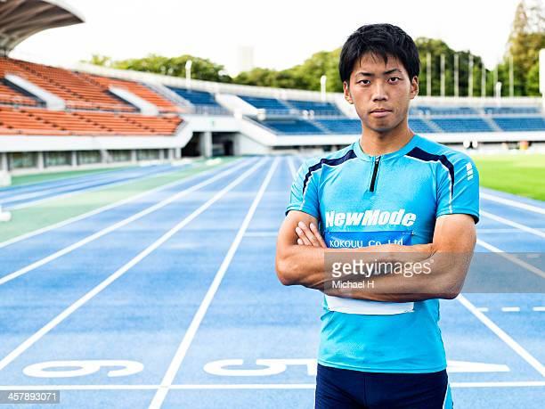 male athlete stands in the stadium - 陸上選手 ストックフォトと画像