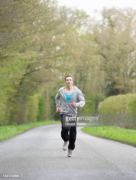 Male athlete training in countryside.
