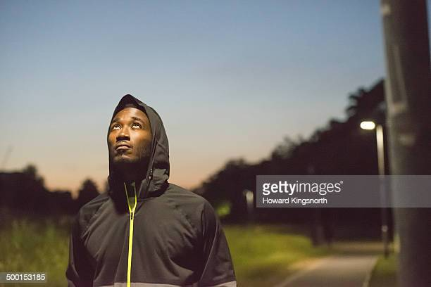 male athlete, urban setting at night