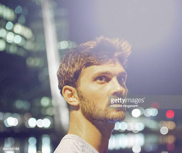 male athlete, urban setting at night - focus on foreground stock pictures, royalty-free photos & images