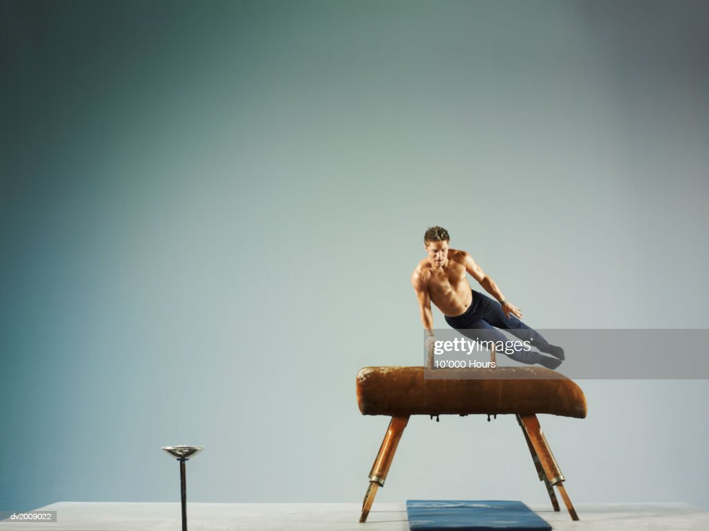 Male Athlete Using a Pommel Horse : Stock Photo
