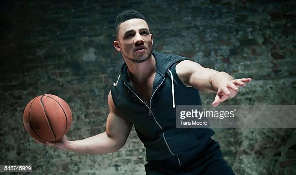 Male athlete with basketball brick background