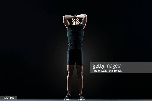 male athlete with hands covering eyes - sportsperson stock pictures, royalty-free photos & images