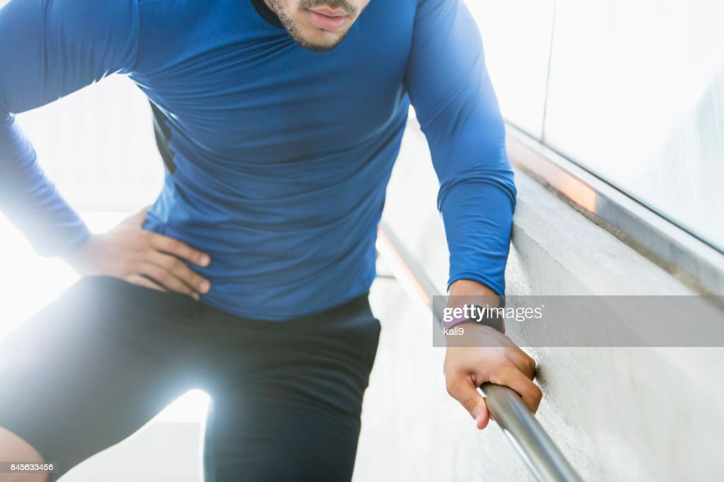 Male athlete with hip injury : Stock Photo