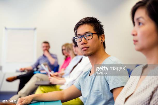 Male Attending in a Business Presentation