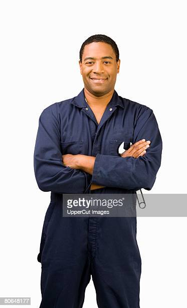 Male auto mechanic with arms crossed