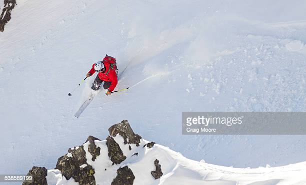 A male backcountry skier makes his way down a slope in the Beehive Basin near Big Sky, Montana.