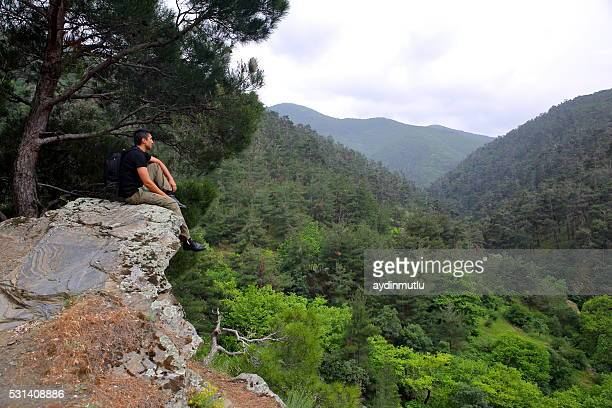 Male backpacker sitting on Mountain