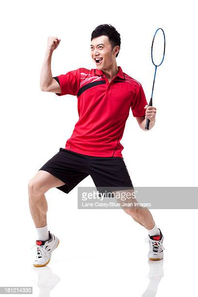 Male badminton player celebrating with excitement