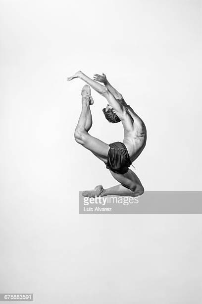 Male ballet dancer against white background