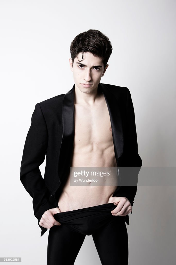 Male ballet dancer in a suit jacket : Stock Photo